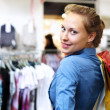 Woman in a shop buying clothes — Stock Photo #6840830