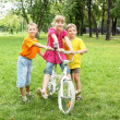 Girls with a bike in the park — Stock Photo #6841777