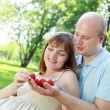 Young couple on picnic in the park — Stok fotoğraf