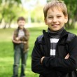 Boy with a friend in the green park — Stock Photo #6842536