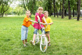 Girls with a bike in the park — Stock Photo