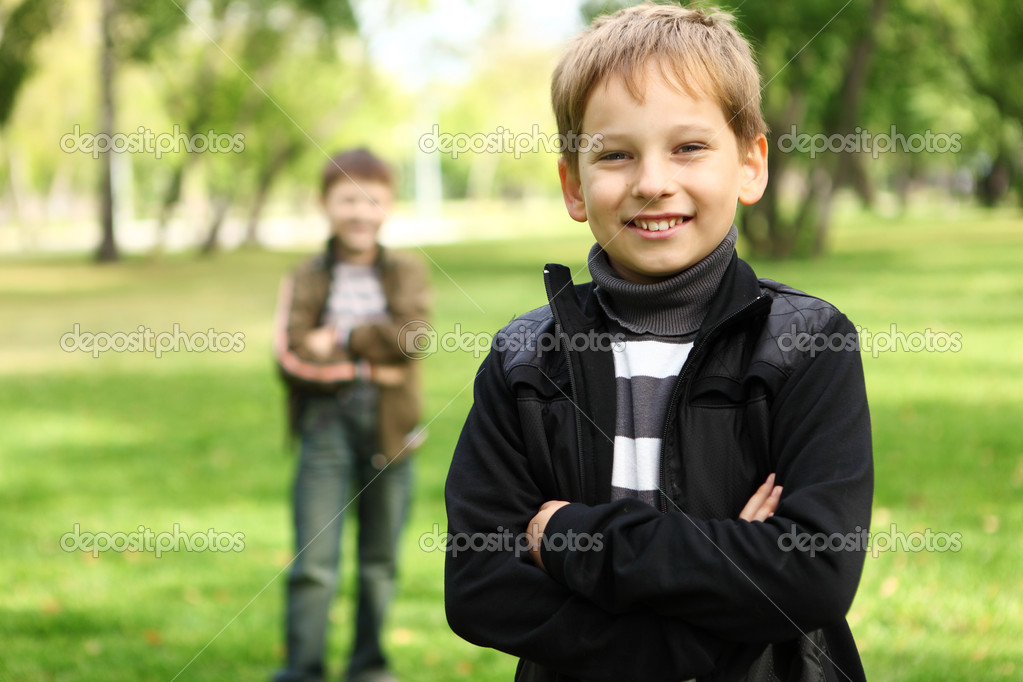 Happy smiling boy with a friend in the green park  Stock Photo #6842536