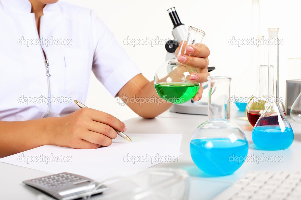 Young female scientist in a chemistry laboratory — Stock Photo #6843956