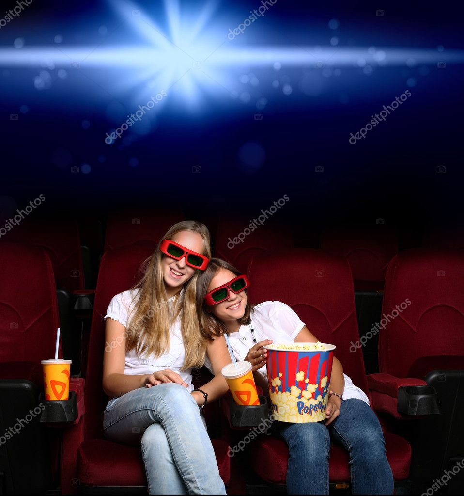 Two young girls watching movie in cinema — Stock Photo #6844175