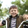 Boy on a bicycle in the green park — Stock Photo #6853417