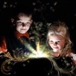 Children opening a magic gift box — Stock Photo