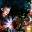 Royalty-Free Stock Photo: Child opening a magic gift box