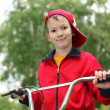 Boy on a bicycle in the green park — Stock Photo #6855154