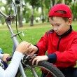 Boy on a bicycle in the green park — Stock Photo #6855155