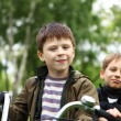 Boy on a bicycle in the green park — Stock Photo #6855322