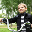 Boy on a bicycle in the green park — Stock Photo #6855324