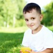 Portrait of a little boy in the park — Stock Photo #6855352