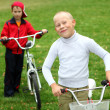 Boy on a bicycle in the green park — Stock Photo #6855356