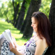 Portrait of pregnant woman in the park - Photo