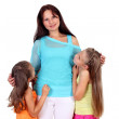 Mother with her two daughters in studio — Stock Photo