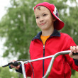 Boy on a bicycle in the green park — Stock Photo #6855434