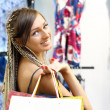 Young girl buying clothes - Stock Photo