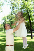 Grandfather with granddaugther outside — Stock Photo