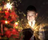 Child opening a magic gift box — Stock Photo