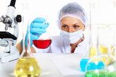 Female scientist in a chemistry laboratory — Stock Photo