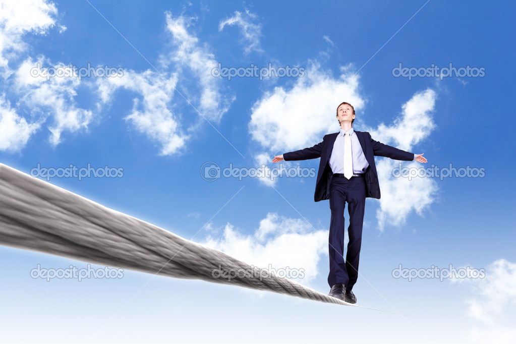 Business man balancing on the rope high in the sky — Stock Photo #6855303