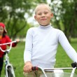 Boy on a bicycle in the green park — Stock Photo #6889105