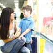 Young mother and son doing shopping — Stock Photo