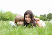 Itlle girl with her mother outdoors — Stock Photo