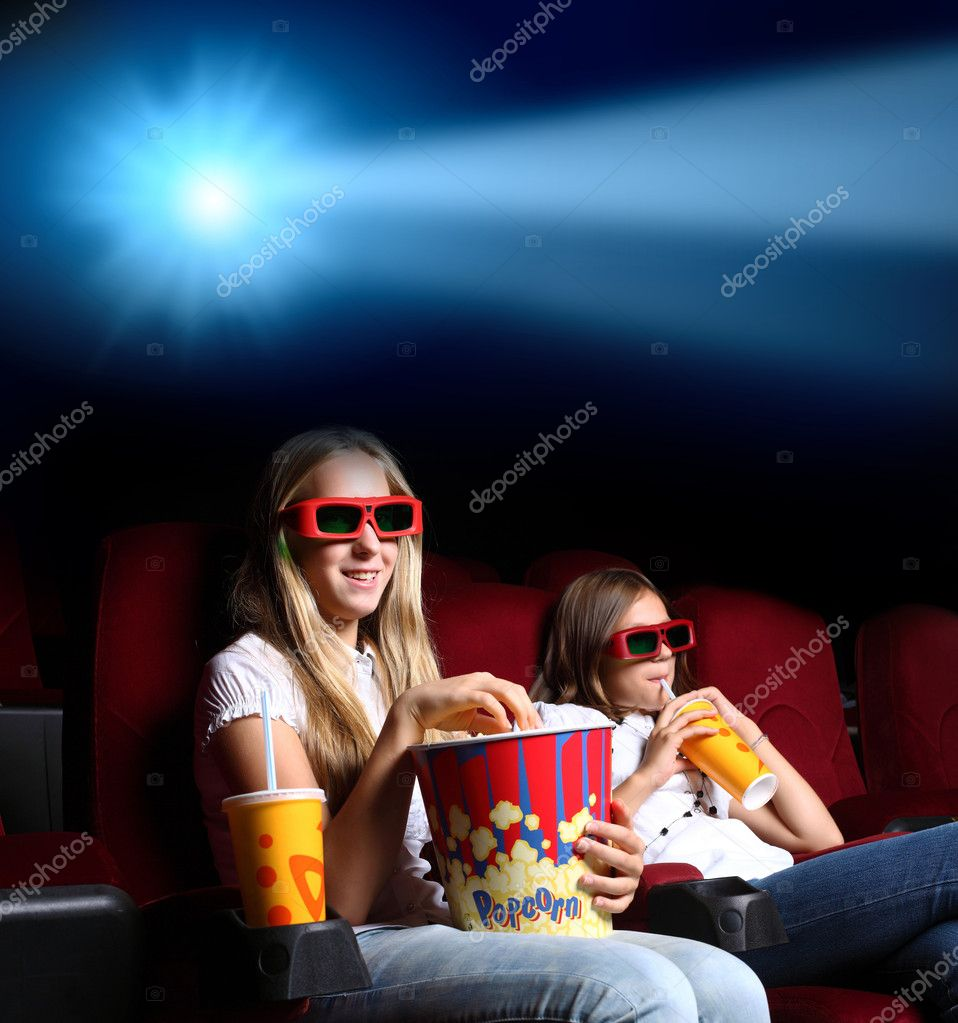 Two young girls watching movie in cinema — Stock Photo #6889245
