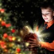 Child opening a magic gift box — Foto Stock
