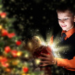 Child opening a magic gift box — Stockfoto