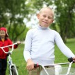 Stock Photo: Boy on a bicycle in the green park