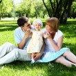 Young family together in the park — Stock Photo #6900756