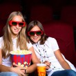 Two young girls in cinema — Stock Photo #6900981