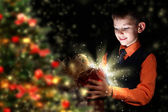 Child opening a magic gift box — Stock Photo