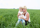 Portrait of mother with her son outdoors — Stock Photo
