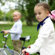 Girl on a bicycle in the green park — Stock Photo #6924466