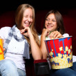 Two young girls watching in cinema — Stock Photo #6924598