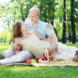 Foto de Stock  : Young couple on picnic in the park