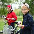 Boy on a bicycle in the green park — Stock Photo #6924643