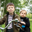 Boy on a bicycle in the green park — Stock Photo #6924663