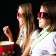 Two young girls watching in cinema — Stock Photo #6924761