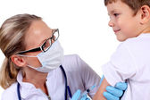 Doctor doing vaccine injection to child — Stock Photo