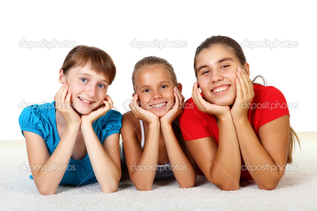 Three teenage girls together in studio against white background — Stock Photo #6924827