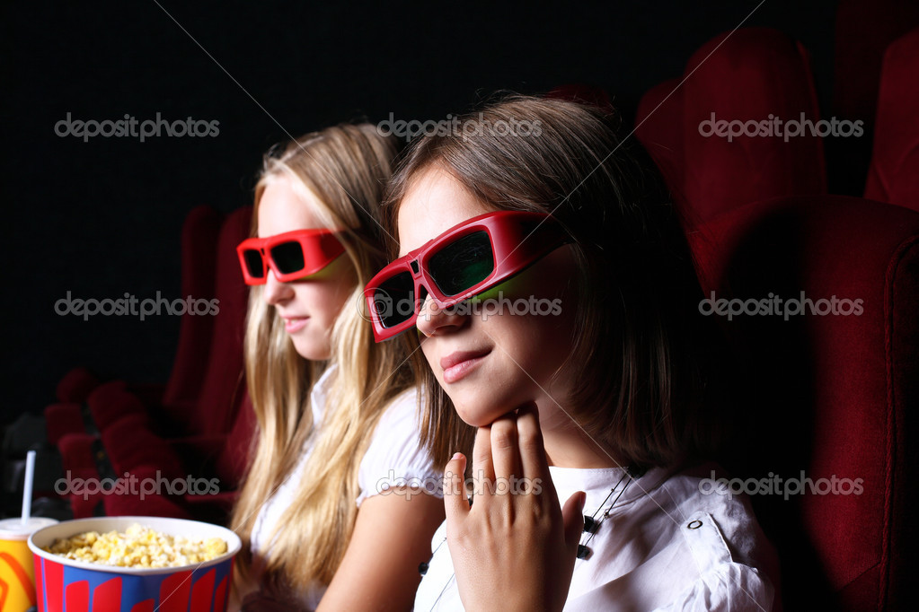 Two young girls watching movie in cinema  Stock Photo #6924925