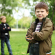 Boy with a friend in the green park — Stock Photo #6931862