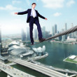 Business man balancing on the rope — Stock Photo