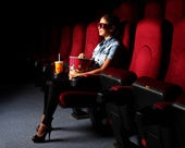 Young girl in cinema — Foto Stock