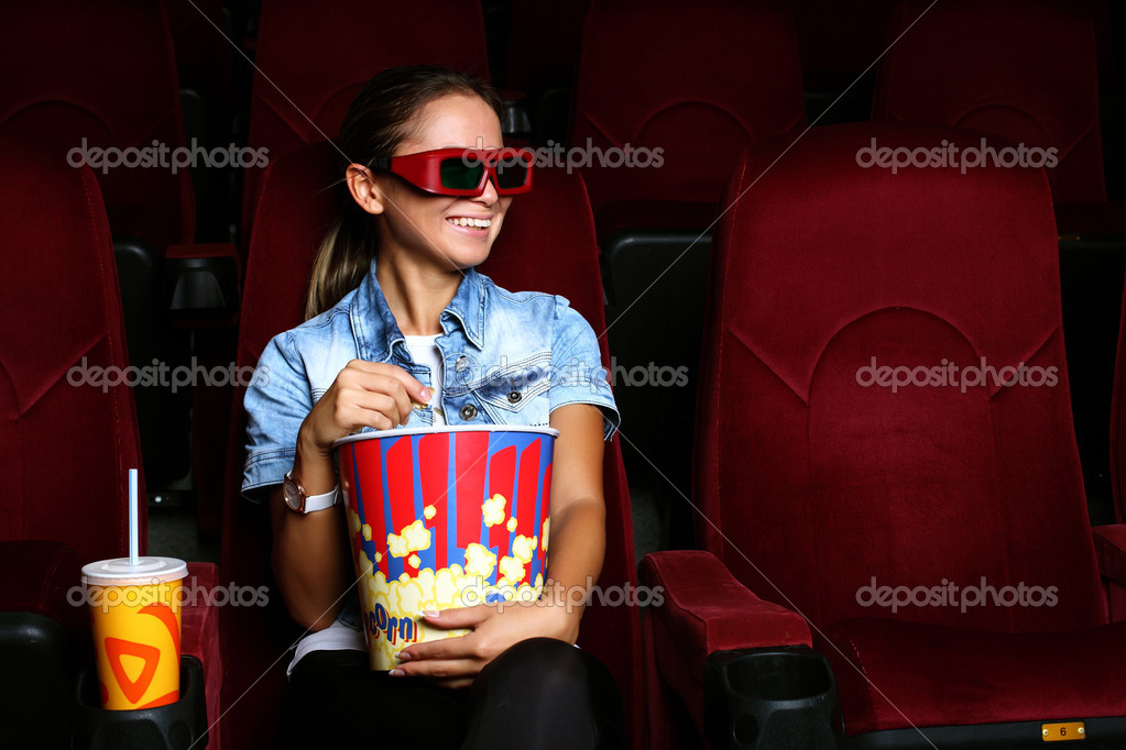 One young girl watching movie in cinema — Stock Photo #6932118