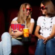 Two young girls watching in cinema - Lizenzfreies Foto